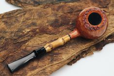 Clean, elegant shaping, superior finishes, and beautifully organic accents define today's batch of Cornelius Mänz pipes, all featuring either horn or bamboo.