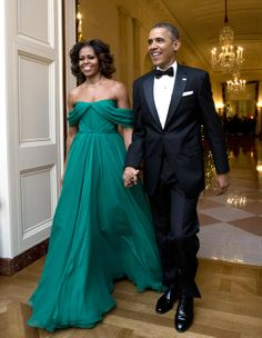 Michelle Obama wearing an emerald green gown by Marchesa to the Kennedy Center Awards.