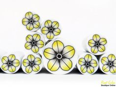 Jaune, noir et blanc la canne de fleur millefiori argile polymère, argile polymère brute et non cuites Fimo canne par Ronit Golan