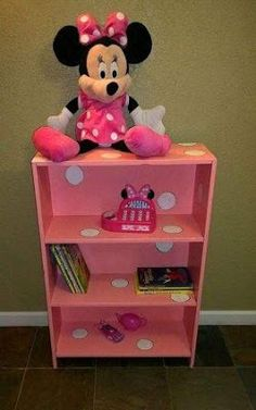 a broken,thrift bookcase, redone into pink w/white polka dots, perfect for Minnie Mouse Room :) Suzanne Wright Photography. CHLOE BEAR 🐻 WOULD Love ❤ This OK 👌 Love ❤ Nikki Minnie Mouse Room Decor, Minnie Mouse Nursery, Mickey Mouse, Casa Disney, Disney Rooms, Girl Nursery, Girls Bedroom, Deer Nursery, Toddler Rooms
