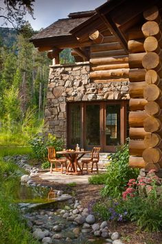 log cabin splendor, with a babbling brook right by the patio!