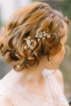 romantic messy loose curls wedding updo with pearl pin