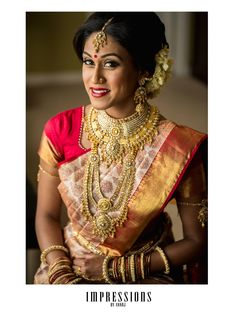 South Indian bride. Temple jewelry. Jhumkis.Cream and red silk kanchipuram sari.Braid with fresh jasmine flowers. Tamil bride. Telugu bride. Kannada bride. Hindu bride. Malayalee bride.Kerala bride.South Indian wedding