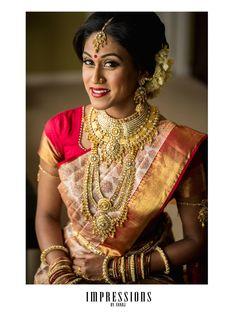South Indian bride. Temple jewelry. Jhumkis.Cream and red silk kanchipuram sari.Braid with fresh jasmine flowers. Tamil bride. Telugu bride. Kannada bride. Hindu bride. Malayalee bride.Kerala bride.South Indian wedding
