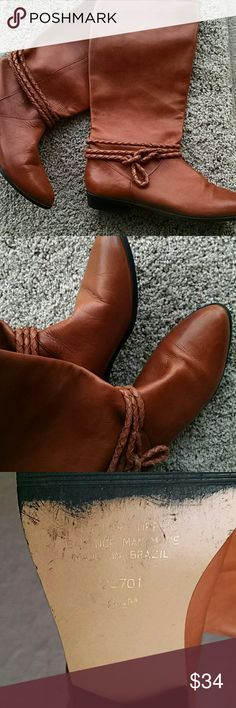 Leather boots Wild child boots made in Brazil.  Approximately 14 inches high. Says size 8 1/2 but I wear 8 and with socks fine for me.  Beautiful rust colored leather n good condition. I've only worn maybe 4 times as I need a heel for my long Levy's. Hate to part with them but they're not being used. Wild Child  Shoes Combat & Moto Boots