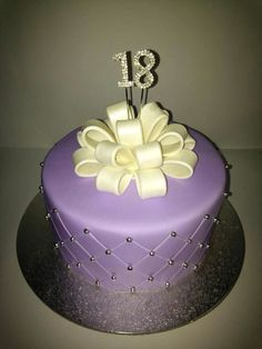 18th birthday cake with Pom Pom bow and quilting in cake. Made by me.