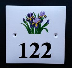 House Number Sign with Irises  Hand painted ceramic house number signs with paintings of birds, flowers, trees, animals and more. See our many picture choices on our website www.handpaintedhousesigns.co.uk