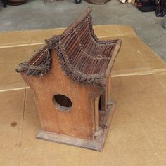 Temple or pagoda style wooden birdhouse.not sure what roof material is. weighs 1.10 lbs 10 1/4 h x 8 length x 7 depth.inches looks pretty decent overall,some stains and scratches here and there.used condition