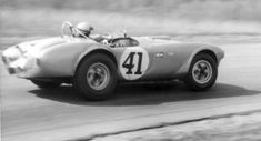 Mark Donohue working hard in a Shelby Cobra …