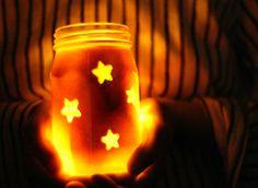 DIY Fourth of July Star Jars -------Mason Jars, Red Spray Paint, Star Stickers & Newspaper