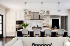 Our Hood classic globe pendants make a bold yet simple statement in this Georgia renovation by TerraCotta Properties via houzz.com. #kitchenlighting #luminary #renovations