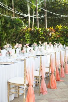 #spring outdoor #wedding reception decor with stunning ombre fabric draped over the back of the chairs.