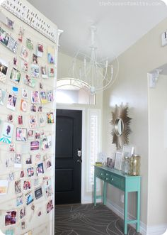 Decorated Entryway - thehouseofsmiths.com LOVE LOVE the door painted black on the inside!