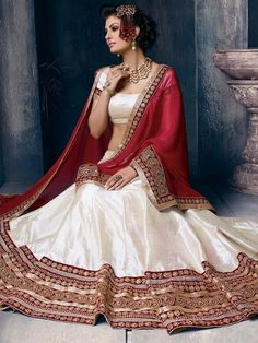 Magnificent off white color #Silk #Lehenga is garnished with #Zari, #Kundan, #Stones work. Item code: GKRI1203A http://www.bharatplaza.com/new-arrivals/lehengas.html