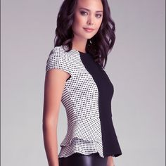 """Bebe Panel Peplum Top Peplum pampered. Our top is super sexy with a paneled front design and double layered. Checkered style with cap sleeves. Yes. 60% Rayon, 35% nylon, 5% spandex Imported Center back to hem: 21"""" (53 cm). NWOT bebe Tops Blouses"""
