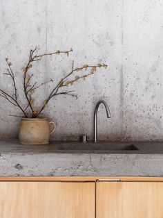 Minimalist Concrete Kitchen in Swiss Alp Cabin #bunkerplans