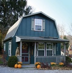 Gambrel roof gives much more headspace on the upper floor that the usual gable roof.