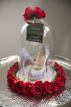 Double duty wedding idea: incorporate the bride's formal wedding shoes into a unique centerpiece at the reception.| Photo: Blumenthal Photography, Australia