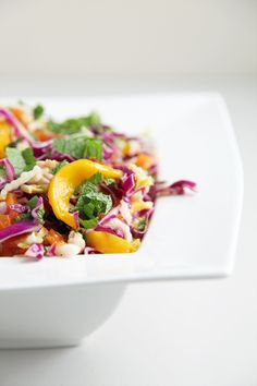 Spicy mango, papaya, and cabbage slaw.  Bunch of possibilities for substituting and adding whole grains.