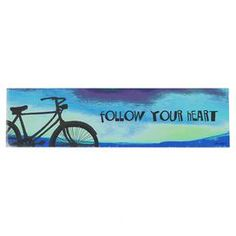 "Ready-to-hang wood wall sign with a bicycle and text motif.  Product: Wall artConstruction Material: Wood Color: MultiFeatures: Ready to hangDimensions: 6"" H x 22"" WNote: All hardware includedCleaning and Care: Wipe with a damp cloth"