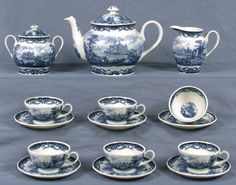 Blue Victorian Castle Toile Porcelain Tea Set measures Teapot 7.5 in. high x 7 in. wide, Sugar 5.5 in. high, Creamer 5 in. high, (6) Cups 2.25 in. high, (6) Saucers 6 in. wide.