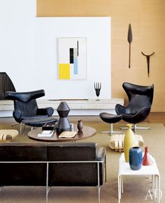 In the living room are a 1956 Hans Wegner Ox chair and ottoman, left, a 1958 Arne Jacobsen Egg chair and an untitled 1957 John McLaughlin oil.