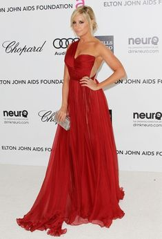 Ashley Tisdale was ravishing in this rich red evening gown at the Elton John Oscar viewing party. Brand: Maria Lucia Hohan