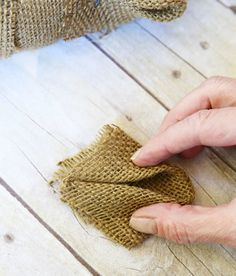 Once resigned to sacking potatoes, burlap is all the rage this year. By simply folding pieces of burlap two different ways, the quaint fabric morphs into two very different, chic Christmas wreaths.