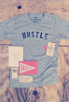 Limited Issue Hustle Shirt  Neuarmy Surplus | Limited Issue Hustle Shirt in an edition of 25.  The front of each shirt was individually typeset by hand using vintage woodtype. As a result, the letter-spacing is varied, and each impression distinct (some light, others dark), making each shirt unique and perfectly imperfect.