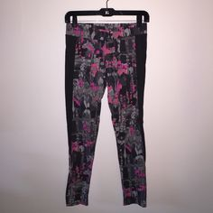 Aerie leggings Aerie leggings, shades of pink and gray pattern on front and back, dark gray panels on the sides. Never worn aerie Pants Leggings