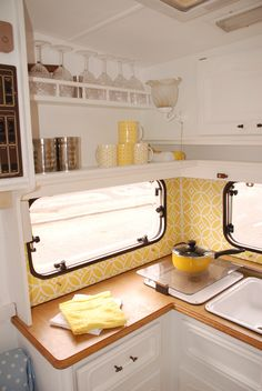 caravan makeover.cheerful,bright, and cabinets that aren't too deep. nice.