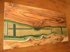 Live edge river table with glowing resin fillin