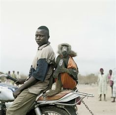 The road to Abuja , Nigeria . South African photographer, Pieter Hugo .      http://www.pieterhugo.com/the-hyena-other-men/