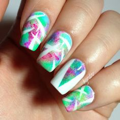 http://www.lacquerstyle.com/2013/06/abstract-neon-tape-mani-tutorial.html