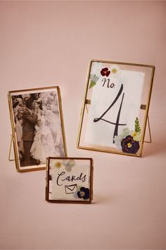 DIY press and dry flowers from an event, then include in a glass frame with picture (make sure flower is dry or protect photo with wax paper where the flower overlaps)