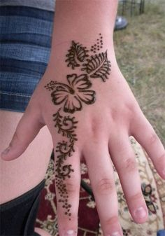 Henna Hand design featuring a Hibiscus Flower. Henna Paste and Henna Kits Available on my Etsy Shop Henna Hibiscus Hand Mehandi Designs For Kids, Cool Henna Designs, Floral Henna Designs, Mehndi Art Designs, Henna Tattoo Designs, Mehndi Designs For Hands, Henna Tattoos, Tattoo Ideas, Mehendi