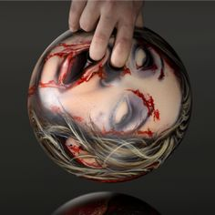 Famed spray gun artist took 3 weeks to create these gruesome, highly detailed Zombie Head Bowling Balls.