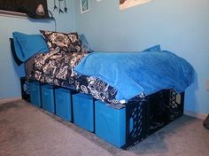 Milk Crate Bed ~ 18 crates, fabric drawers from target, and zip ties....The open ones at the bottom I'm using to store boots. I'm happy with it... And they can be repurposed for shelves and stuff down the road! Created by my daughter, Kristen Engman