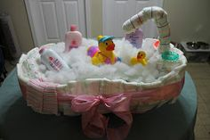 "Diaper Tub:35 diapers + 21 extras, 1-baby bathtub, 1-baby bath gel, 1-baby powder, 1-baby lotion, 2-teething rings, 2-baby wash cloths, 1-Sm rubber ducky that takes the waters temperature, 1-lg rubber ducky that covers the tub's water spout, a little poly foam & 2"" wired ribbon"