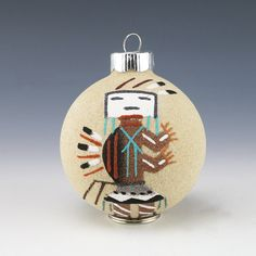 Splendid Christmas ball ornament with sand painting of Kokopelli.  3  1/2″ tall x 2  5/8″ wide x 2  5/8″ long Christmas Balls, Christmas Ornaments, Navajo People, Sand Painting, Colored Sand, Handmade Ornaments, Ball Ornaments, Restoration, Holiday Decor