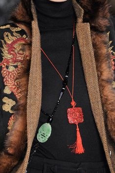 Ralph Lauren Fall 2011 - Details: While not a brooch, I have my Grandmother's necklace like this in tan.