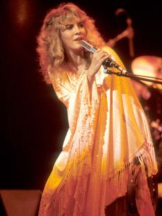 Stevie Nicks' dress is listed by Good Housekeeping as one of The 100 Most Memorable Dresses of All Time. Honestly, it could be any of her dresses and shawls.