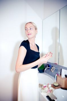 Vogue Daily — Claire preps her skin in the white-washed bathroom of her new downtown apartment.     Photographed by Leslie Kirchhoff