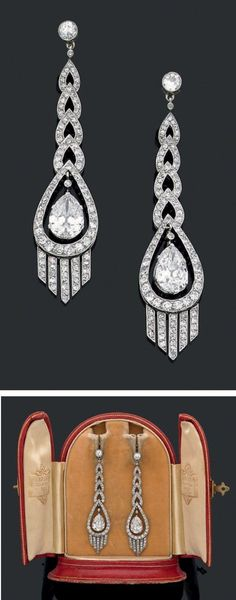 An elegant pair of Art Deco platinum, white gold and diamond earrings, about 1920. Length 6.3cm. #ArtDeco #earrings