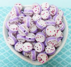 You get 25 pretty glittery shiny purple and pink 13mm lovely resin beads as in the picture!!  Holes measure 2mm  These are some tasty beads