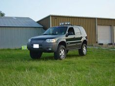 "Ford Escape 4x4 Lifted | lift kit 1"" avec tire all terrain"