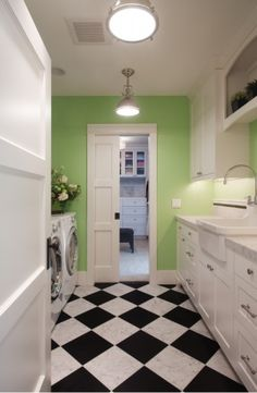 sweet laundry room. love the lights by sofia