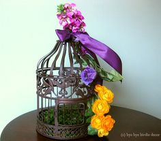 birdcage decorated with flowers