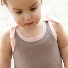 Rosy cheeks! How adorable does this little one look in our Azalea dress?