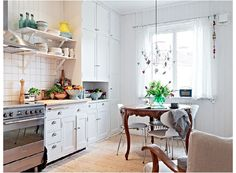 love a white kitchen :}